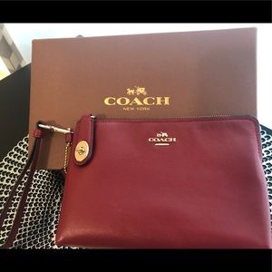 COACH Red Small Leather TurnLock Pouch Wristlet.